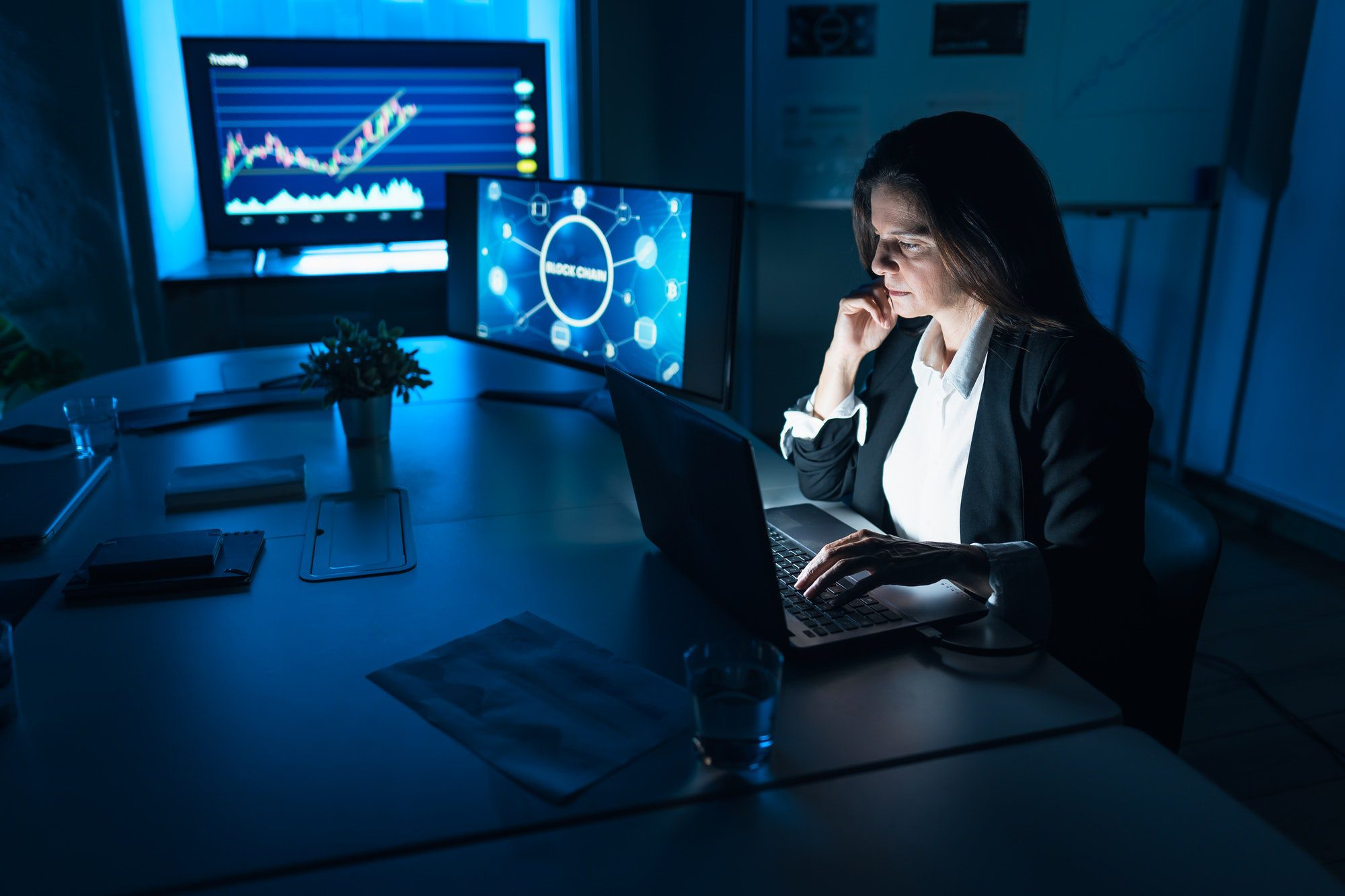 Business stock trader woman working on crypto currency markets with blockchain technology